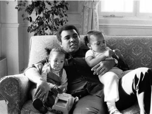 Ali with his children on his lap.