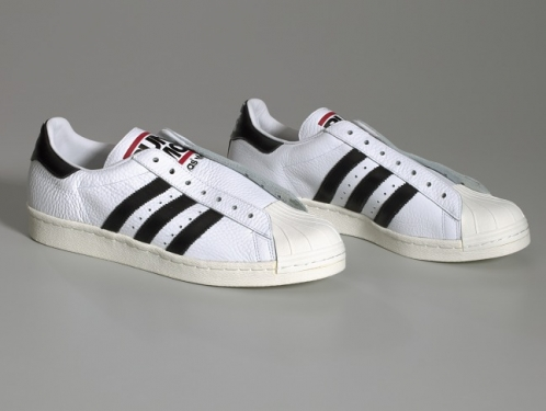 Pair of white and black Run-D.M.C. Superstar 80s sneakers made by Adidas