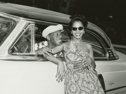 man and woman embracing through an open car window