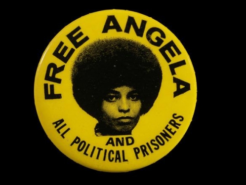 Pinback button with FREE ANGELA AND ALL POLITICAL PRISONERS.