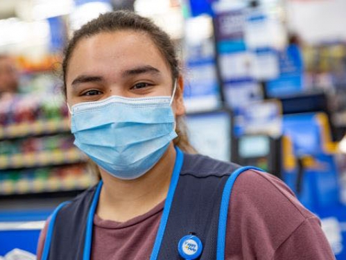 Woman wearing a surgical mask.