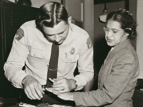 Rosa Parks being fingerprinted