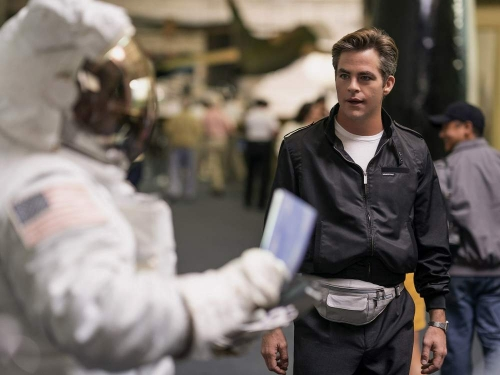 Man and a replica space suit.