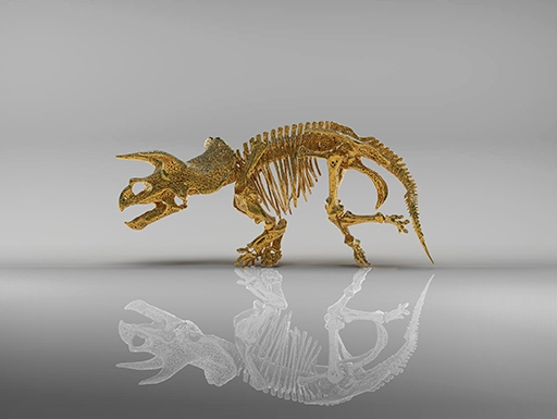 golden 3D-printed skeleton of triceratops with white reflection