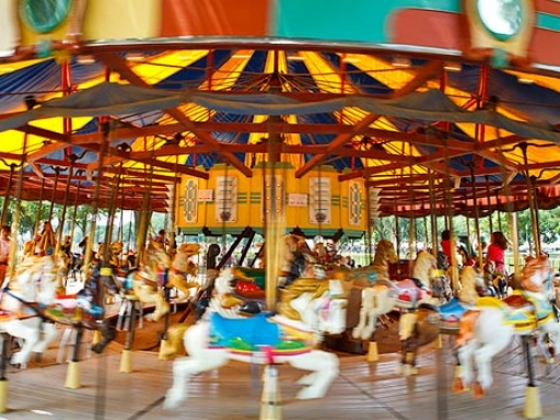 Carousel with brightly decorated horses.