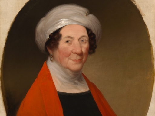 Dolley Madison in turban with a black dress and a red shawl.