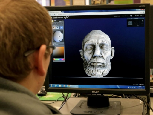 Educator looking at Lincoln 3d mask.