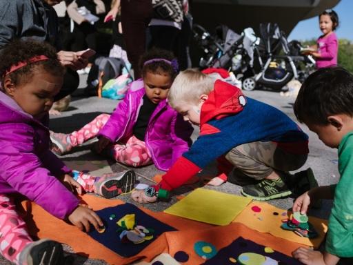 Kids sitting in Hirshhorn Plaza for STORYTIME program.