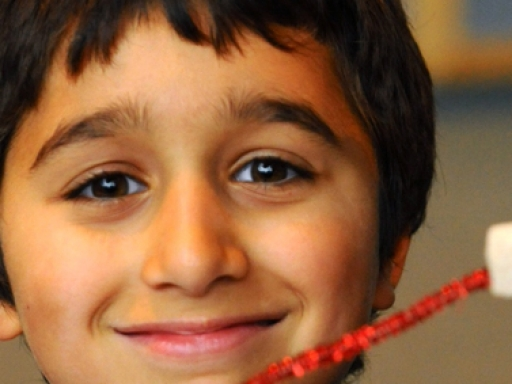 Smiling male child with craft.