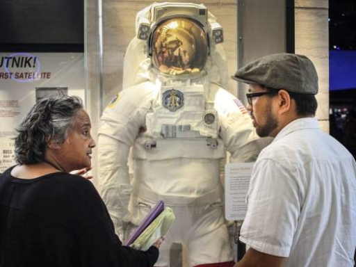 scholars with space suit
