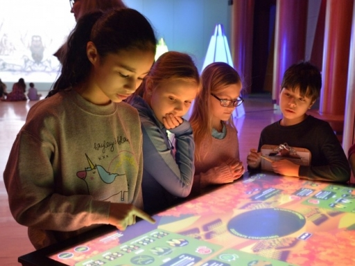 kids using interactive table.