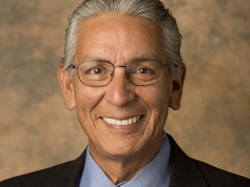 Kevin Gover in a dark suit and yellow tie