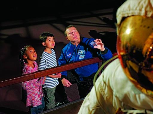 astronaut meets children