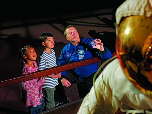 astronaut meets children