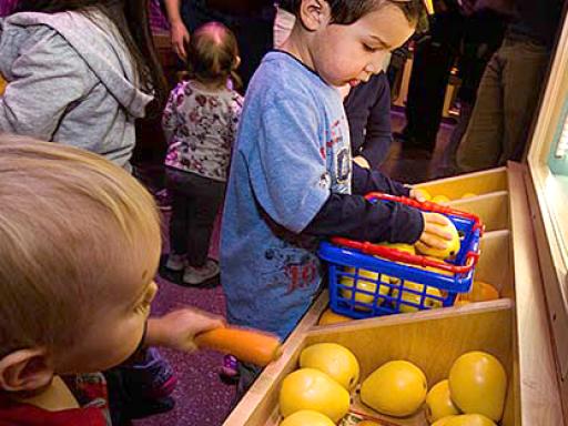 children pretend grocery shopping.