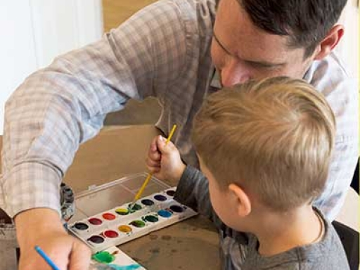parent painting with a child.