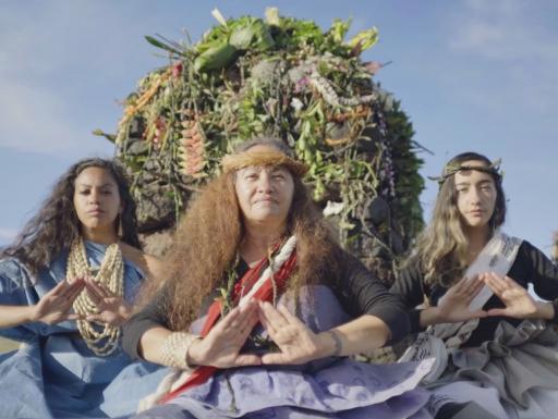 Polynesian women on catamarand, making prayerful gesture