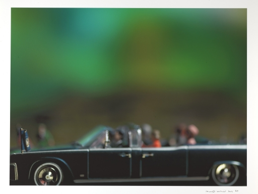 Miniatures posed in a car depicting the Kennedy assassination.