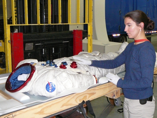 Samantha working with an Apollo 17 suit.