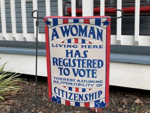 "red, white, and blue garden with text: ""A Woman Living Here Has Registered to Vote Thereby Assuming Responsibility of Citizenshi"