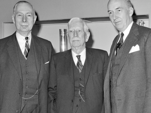 3 secretaries in suits.