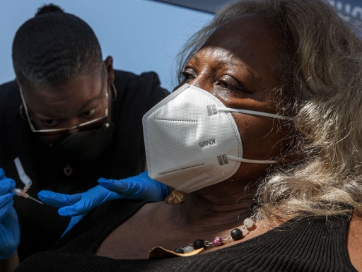 A Pfizer COVID-19 vaccine is administered at a mobile clinic in Los Angeles county, which has pockets of vaccine hesitancy