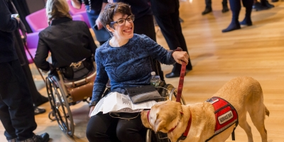 participant with service dog at Cooper Hewitt Lab: Design Access symposium photo by Scott Rudd