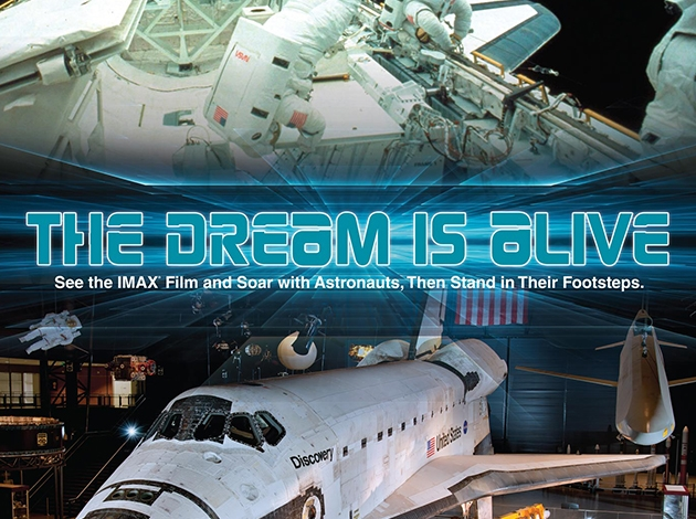 """picture of a space station and the discovery space shuttle with the words """"the dream is alive"""" going across"""