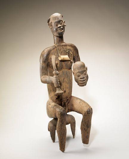 Figure of King Bay Akiy carved in wood.