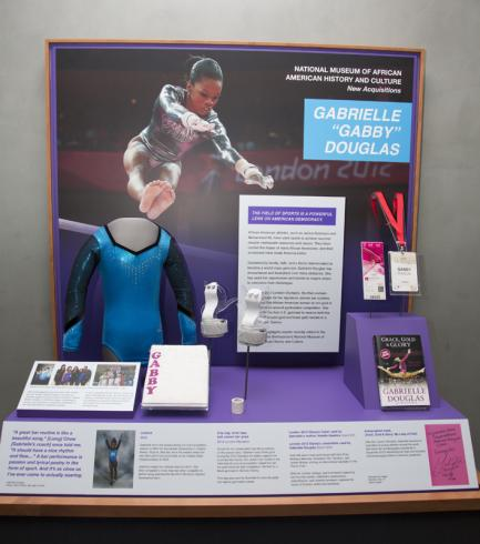 Leotard and other items in display case