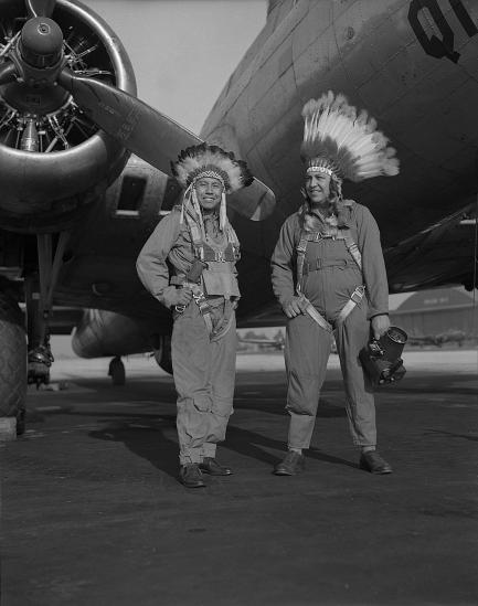 Gus Palmer and Horace Poolaw in front of aircraft