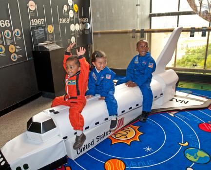 Children playing with model space shuttle