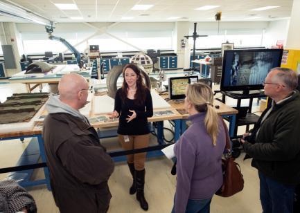 Visitors talk to conservator