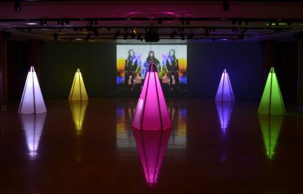 Art installation of neon tipis