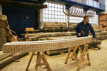 Man working on wooden boat