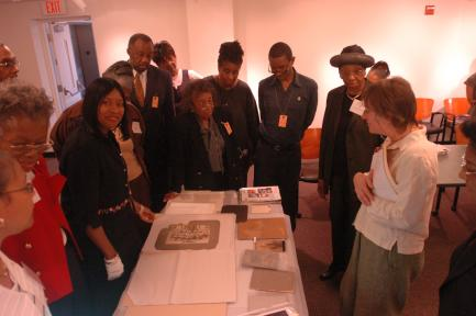 Archivist Jennifer Morris discusses photographic conservation techniques with participants in the Religious Archives Institute. Exhibition: Your Community. Your Story: Celebrating Five Decades of the Anacostia , 1967-2017
