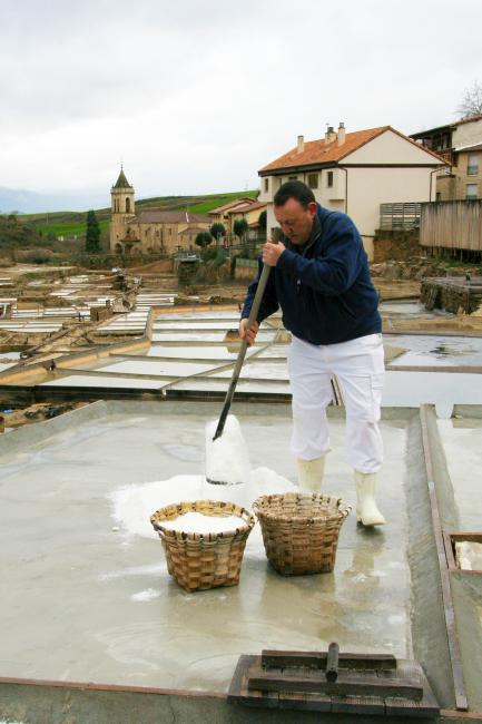 Man spreading salt to dry