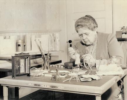Frances Glessner working on model