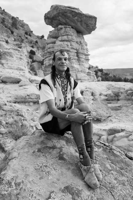Archuleta sitting on a rock