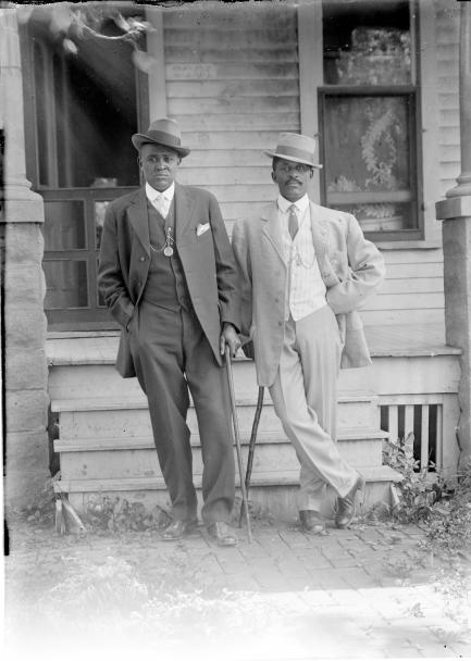 George W. Butcher and friend wearing suits and leaning on canes