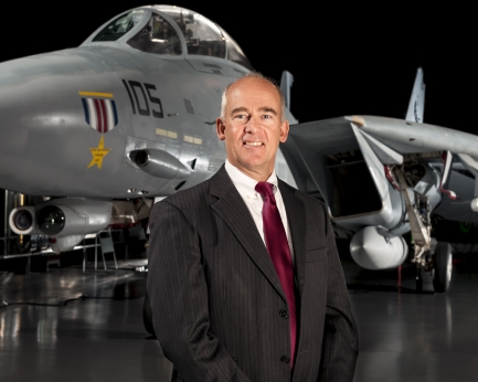 Christopher Browne with aircraft in background