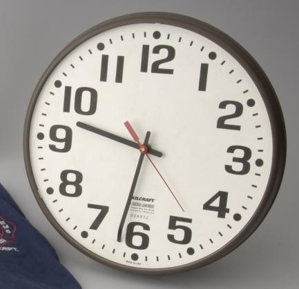 Office clock showing time of 9:32