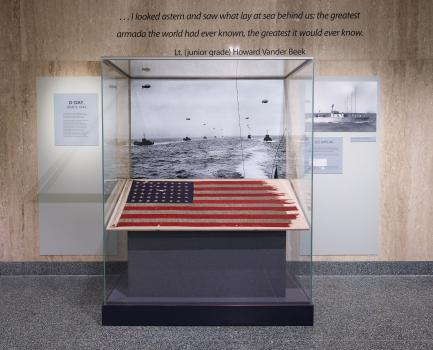 Tattered American flag in display case