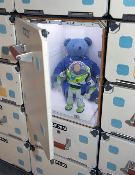 Buzz Lightyear and Magellan T. Bear in Space