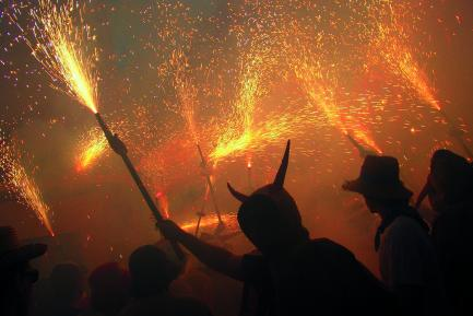 People in devil costumes