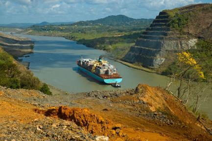 cargo ship traversing Panama Canal