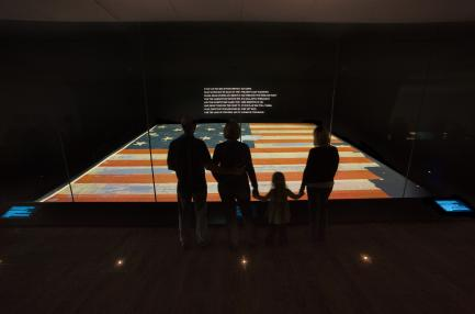 Family viewing the Star-Spangled Banner