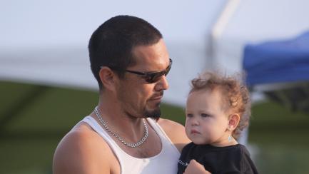 Man holds toddler