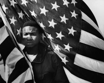 Man carrying American flag