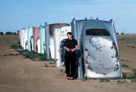 Jane Stern at Cadillac Ranch (hald buried cars)